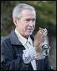 President George W. Bush holds a screech owl Saturday, Oct. 20, 2007 at the Patuxent Research Refuge in Laurel, Md., where President Bush discussed steps his Administration is creating for a series of cooperative conservation steps to preserve and restore critical stopover habitat for migratory birds in the United States. White House photo by Eric Draper