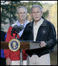 President George W. Bush, joined by U.S. Interior Secretary Dirk Kempthorne, addresses his remarks Saturday, Oct. 20, 2007 at the Patuxent Research Refuge in Laurel, Md., discussing the steps his Administration is creating for a series of cooperative conservation steps to preserve and restore critical stopover habitat for migratory birds in the United States. White House photo by Eric Draper