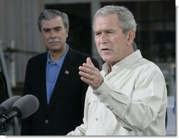 President George W. Bush gestures as he addresses his remarks prior to signing an Executive Order to protect the striped bass and red drum fish populations Saturday, Oct. 20, 2007, at the Chesapeake Bay Maritime Museum in St. Michaels, Md. U.S. Secretary of Commerce Carlos Gutierrez is seen background. White House photo by Eric Draper