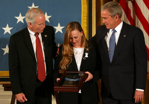 President George W. Bush stands with Dan and Maureen Murphy, parents of Lt. Michael P. Murphy, after the Navy SEAL was honored posthumously with the Medal of Honor during ceremonies Monday, Oct. 22, 2007, in the East Room of the White House. White House photo by Joyce N. Boghosian