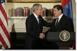 "President George W. Bush shakes hands with President Nambaryn Enkhbayar of Mongolia, Monday, Oct. 22, 2007, in the Roosevelt Room of the White House, where the two leaders signed the Millennium Challenge Corporation Compact. Said President Bush: ""The Millennium Challenge Compact encourages countries to make a firm commitment to basic principles, principles that mean the government will listen to their people and respond to the needs of the people.We honor the success of your country and the commitment of your government to basic principles."" White House photo by Eric Draper"