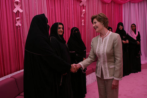 Mrs. Laura Bush meets one-on-one with women in the Pink Majlis Monday, Oct. 22, 2007, at the Sheikh Khalifa Medical Center in Abu Dhabi, United Arab Emirates. The Majlis is a tradition of open forum for a wide range of topics. The Majlis focuses issues related to breast cancer. White House photo by Shealah Craighead