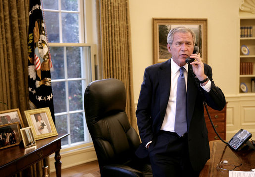 President George W. Bush speaks with California Gov. Arnold Schwarzenegger Monday, Oct. 22, 2007, regarding the wildfires burning throughout the Southern California area. White House photo by Eric Draper