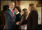 President George W. Bush greets his guests Marlenis Gonzalez, right, and her daughter Melissa, center, Wednesday, October 24, 2007, after his remarks on Cuba policy at the State Department in Washington, D.C. Melissa's father, Jorge Luis Gonzalez Tanquero is currently being held in a Cuban prison after being arrested for crimes against the regime. White House photo by Eric Draper