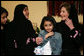 "Mrs. Laura Bush talks with Dr. Samia Al-Amoudi, a breast cancer survivor, during a ""Breaking the Silence"" Coffee Wednesday, Oct. 24, 2007, in Jeddah, Saudi Arabia. Mrs. Bush met with breast cancer survivors and members of their families to discuss awareness issues. Pictured at left is Dr. Samia's daughter, Esraa Al-Harbi, 10-year-old author of a children's book entitled, ""My Mother and Breast Cancer."" The child at center is unidentified. White House photo by Shealah Craighead"