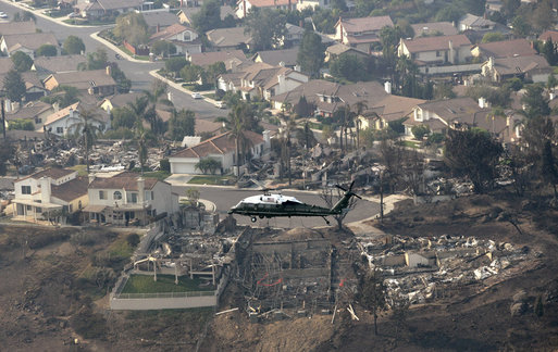 President George W. Bush, aboard Marine One, receives an aerial tour of fire-ravaged Southern California Thursday, Oct. 25, 2007. At least three people have died since the fires began and thousands have been evacuated from their homes. White House photo by Eric Draper