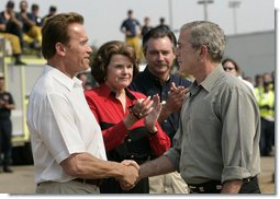 "President George W. Bush shakes hands with California Governor Arnold Schwarzenegger as he talks with the media after touring the Rancho Bernardo neighborhood Thursday, Oct. 25, 2007, with Senator Dianne Feinstein, R-Calif., and FEMA Director David Paulison. Said the President: ""To the extent that people need help from the federal government, we will help. My job is to make sure that FEMA and the Defense Department and the Interior Department and Ag Department respond in a way that helps people get the job done."" White House photo by Eric Draper"