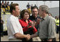 "President George W. Bush shakes hands with California Governor Arnold Schwarzenegger as he talks with the media after touring the Rancho Bernardo neighborhood Thursday, Oct. 25, 2007, with Senator Dianne Feinstein, D-Calif., and FEMA Director David Paulison. Said the President: ""To the extent that people need help from the federal government, we will help. My job is to make sure that FEMA and the Defense Department and the Interior Department and Ag Department respond in a way that helps people get the job done."" White House photo by Eric Draper"
