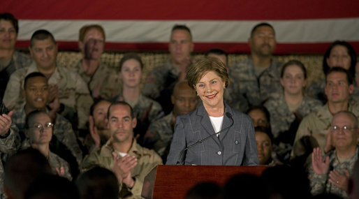 "Mrs. Laura Bush addresses American troops Thursday, Oct. 25, 2007, at Ali Al Salem Air Base near Kuwait City. ""With your courage and compassion, you show that the United States military is one of the greatest forces for good in the world,"" Mrs. Bush told the troops. ""And I hope you know that we pray. for an end to the violence everywhere so that future generations can grow up in a world at peace -- a world that you shaped."" White House photo by Lynden Steele"