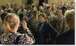Mrs. Laura Bush poses for pictures after addressing American troops Thursday, Oct. 25, 2007, at Ali Al Salem Air Base, Kuwait. It is the third country visited by the First Lady on her four-country, Mideast tour. White House photo by Shealah Craighead