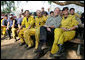 "President George W. Bush visits a base camp Thursday, Oct. 25, 2007, for First Responders battling the Southern California wildfires. ""I'm telling you, there's a lot of folks that live up in these hills that have their houses because of you,"" the President told the fire fighters. "". They're not in a position to thank you -- but we are. And so we thank you for helping save lives and save property."" White House photo by Eric Draper"