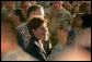 "Mrs. Laura Bush meets troops after addressing them Thursday, Oct. 25, 2007, at Ali Al Salem Air Base near Kuwait City. Mrs. Bush told her audience, ""Ali Al Salem is the first base where American and Kuwaiti flags were flown together. This is the perfect place to recognize the friendship between Kuwait and the United States -- and to thank all of the Kuwaitis who support our American Armed Forces."" White House photo by Lynden Steele"