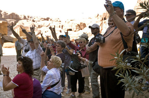 A group of tourists from Texas wave to Mrs. Laura Bush while touring Petra Friday, Oct. 26, 2007, in southern Jordan. Last year more than 300,000 visitors from around the world toured the ancient ruins. White House photo by Shealah Craighead
