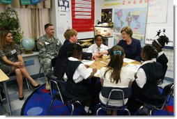 Mrs. Laura Bush shakes hands with student Taylor McIntyre, during her visit with students at the Good Shepherd Nativity Mission School, Thursday, Nov. 1, 2007 in New Orleans, a Helping America's Youth visit with Big Brother and Big Sisters of Southeast Louisiana. Captain Richard T. Douget, second from left, is a Big Brother to Taylor McIntyre. White House photo by Shealah Craighead