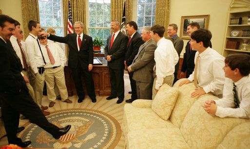Members of the World Series Champion, Warner Robins, Georgia Little League team break out in laughter as President George W. Bush rubs the head of first baseman Micah Wells during a visit Thursday, Nov. 1, 2007, to the Oval Office. The 12-year-old went 1 for 3 in the team's 3-2 championship win over Japan. White House photo by Eric Draper