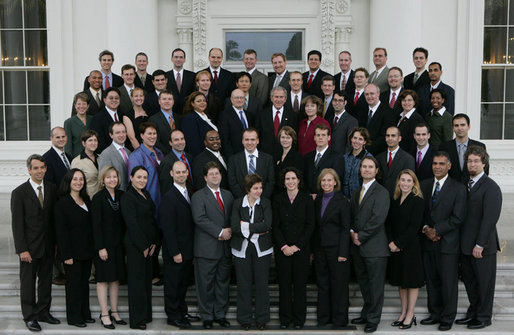President George W. Bush stands amidst recipients of the 2006 Presidential Early Career Awards for Scientists and Engineers during a photo opportunity Thursday, Nov. 1, 2007, on the North Portico of the White House. Established in 1996, PECASE represents the highest honor that any young scientist or engineer can receive in the United States. White House photo by Chris Greenberg
