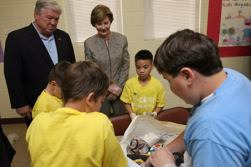 Mrs. Laura Bush visits with Taconi Elementary fifth graders Friday, Nov. 2, 2007, in Ocean Springs, Miss., prior to delivering remarks during the announcement of the Coastal Ecosystem Learning Center Designation and Marine Debris Initiative. The Marine Debris Initiative focuses on identifying, reducing and preventing debris in the marine environment through public and private partnerships, education and international cooperation. White House photo by Shealah Craighead