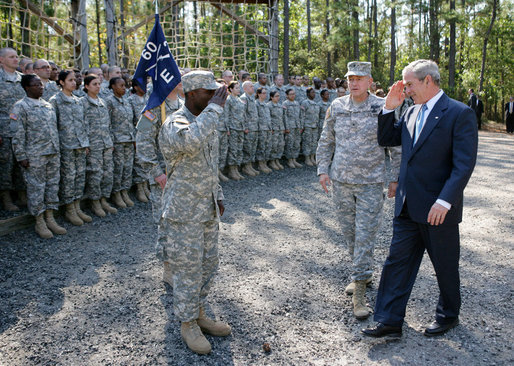 President George W. Bush salutes as he acknowledges members of the 260th Brigade during his visit to Fort Jackson in Columbia, S.C. Fort Jackson is the largest and most active Initial Entry Training Center in the U.S. Army, training more than 50 percent of all soldiers enter the Army each year. With him is Brig. Gen James Schwitter, Commanding General of the base. White House photo by Eric Draper