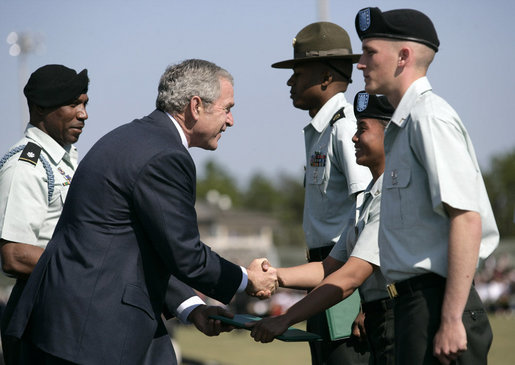 President George W. Bush shakes hands with recipients of outstanding soldier awards during the Basic Combat Training Graduation Ceremonies Friday, Nov. 2, 2007, at Fort Jackson in Columbia, S.C. Fort Jackson is the largest and most active Initial Training Center in the U.S. Army, training an average of 50,000 soldiers per year. White House photo by Eric Draper