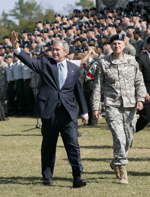 President George W. Bush waves as he and Brigadier General James Schwitters, Commanding General at Fort Jackson, S.C., walk before the graduates Friday, Nov. 2, 2007, during the President's appearance at the Basic Combat Training Graduation Ceremony. White House photo by Eric Draper
