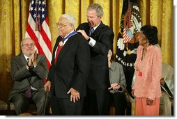 "President George W. Bush awards the Presidential Medal of Freedom to civil rights activist Benjamin Hooks as his wife Frances Hooks stands by during a ceremony Monday, Nov. 5, 2007, in the East Room. ""The nation best remembers Benjamin Hooks as the leader of the NAACP. For 15 years, Dr. Hooks was a calm yet forceful voice for fairness, opportunity, and personal responsibility. He never tired or faltered in demanding that our nation live up to its founding ideals of liberty and equality,"" said the President. White House photo by Eric Draper"