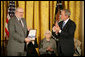 "Robert Hyde accepts the Presidential Medal of Freedom from President George W. Bush on behalf of his father U.S. Representative Henry Hyde, R-Ill., during a ceremony Monday, Nov. 5, 2007, in the East Room. ""Colleagues were struck by his extraordinary intellect, his deep convictions, and eloquent voice,"" said the President. ""In committee and in the House chamber, the background noise would stop when Henry Hyde had the floor."" White House photo by Eric Draper"