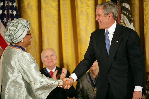 "President George W. Bush awards the Presidential Medal of Freedom to Liberian President Ellen Johnson Sirleaf during a ceremony Monday, Nov. 5, 2007, in the East Room. ""When free elections returned to Liberia, the voters made history,"" said President Bush. ""They chose her to be the first woman ever elected to lead a nation on the continent of Africa."" White House photo by Eric Draper"