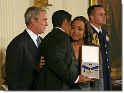 "President George W. Bush presents the Presidential Medal of Freedom to Yan Valdes Morejon and Winnie Biscet in honor of their father Oscar Elias Biscet during a ceremony Monday, Nov. 5, 2007, in the East Room. ""Oscar Biscet is a healer -- known to 11 million Cubans as a physician, a community organizer, and an advocate for human rights,"" said the President about the imprisoned physician. ""The international community agrees that Dr. Biscet's imprisonment is unjust, yet the regime has refused every call for his release."" White House photo by Joyce N. Boghosian"