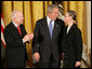 "President George W. Bush congratulates C-SPAN founder Brian Lamb and his wife Victoria during the presentation of the Presidential Medal of Freedom Monday, Nov. 5, 2007, in the East Room. ""For nearly 30 years, the proceedings of the House of Representatives have been televised -- unfiltered, uninterrupted, unedited, and live,"" said the President. ""For this we can thank the Cable-Satellite Public Affairs Network, or C-SPAN. And for C-SPAN, we can thank a visionary American named Brian Lamb."" White House photo by Eric Draper"