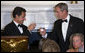 President George W. Bush and President Nicolas Sarkozy of France raise their glasses in toast Tuesday, Nov. 6, 2007, during dinner in the State Dining Room in the honor of the French leader. White House photo by Chris Greenberg