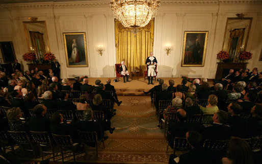 General George Washington (played by Dean Malissa) and General Marie Joseph Paul Yves Roch Gilbert du Motier, the Marquis de LaFayette (played by Benjamin Goldman), entertain the guests Tuesday, Nov. 6, 2007, in the East Room following a dinner in honor of President Nicolas Sarkozy at the White House. White House photo by Chris Greenberg