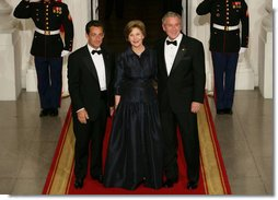 President George W. Bush and Mrs. Laura Bush stand with President Nicolas Sarkozy of France on the North Portico of the White House after his arrival for dinner Tuesday, Nov. 6, 2007. White House photo by Chris Greenberg
