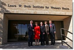 Mrs. Bush shakes hands with Chancellor Kent Hance, Texas Tech University System, as she stands with Dr. Marjorie Jenkins, Erin Thurston and Dr. John Baldwin in front of the Laura W. Bush Institute for Women's Health at TTU, Amarillo Campus Wednesday, Nov. 7, 2007, in Amarillo, Texas. White House photo by Shealah Craighead