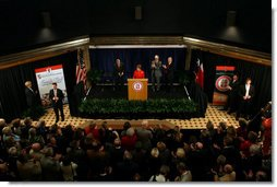 Mrs. Laura Bush delivers remarks during the announcement of the Jenna Welch Women's Center at Texas Tech - Permian Basin Campus Wednesday, Nov. 7, 2007, in Midland, Texas. Mrs. Bush is joined on stage by Speaker Tom Craddick of the Texas House of Representatives, left, Dr. John Jennings, center, and Texas Tech University Chancellor Kent Hance. White House photo by Shealah Craighead