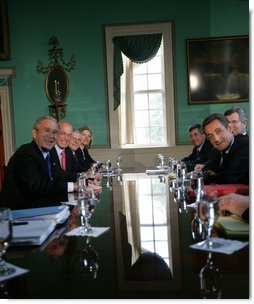 President George W. Bush and President Nicolas Sarkozy of France pause for cameras as they meet in the Large Dining Room at the Mount Vernon Estate in Mount Vernon, Va., Wednesday, Nov. 7, 2007. White House photo by Eric Draper