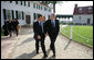 President George W. Bush and President Nicolas Sarkozy of France walk a path from George Washington's mansion during their tour Wednesday, Nov. 7, 2007, of the first president's home. White House photo by Eric Draper