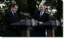 President George W. Bush shares a laugh with President Nicolas Sarkozy of France as they participate in a joint press availability Wednesday, Nov. 7, 2007, at Mount Vernon, Va. White House photo by Eric Draper