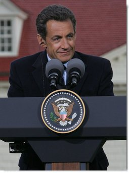 "President Nicolas Sarkozy of France listens to a reporter's question Wednesday, Nov. 7, 2007, during a joint press availability with President George W. Bush at the Mount Vernon Estate in Mount Vernon, Va. President Sarkozy told President Bush, ""I get the distinct sense that it is France that has been welcomed so warmly, with so much friendship, so much love. So when I say that the French people love the American people, that is the truth and nothing but the truth."" White House photo by Chris Greenberg"