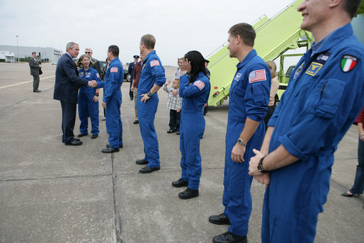 President George W. Bush greets the Space Shuttle Discovery astronauts outside Air Force One, Thursday, Nov. 8, 2007, on the tarmac at Ellington Field in Houston, Texas. President Bush congratulated Space Shuttle Commander Pamela Melroy, left, and fellow astronauts, from left, Pilot George Zamka and mission specialists Scott Parazynski, Stephanie Wilson, Douglas Wheelock, Paolo Nespoli and Clayton Anderson, not seen in photo, on their successful 15-day mission to the International Space Station. White House photo by Eric Draper