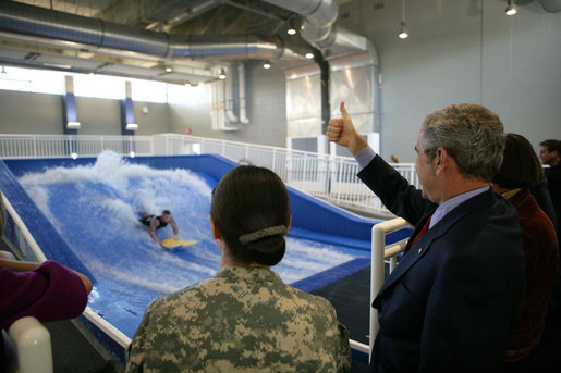 President George W. Bush gives the thumbs up during a Flowrider demonstration, Thursday, Nov. 8, 2007 at the Center for The Intrepid at the Brooke Army Medical Center in San Antonio, Texas. Wounded soldiers use the wave simulation activity to improve balance, coordination and strength. White House photo by Eric Draper