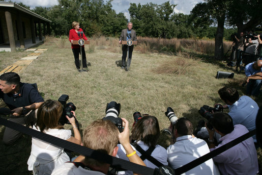 President George W. Bush and German Chancellor Angela Merkel stand before the press following their meeting at the Bush Ranch in Crawford, Texas, Saturday, Nov. 10, 2007. White House photo by Eric Draper