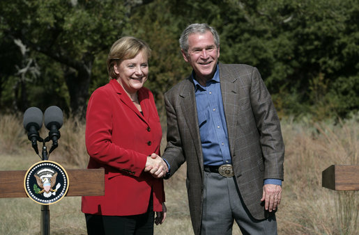 President George W. Bush and German Chancellor Angela Merkel greet each other at the end of their press conference at the Bush Ranch in Crawford, Texas, Saturday, Nov. 10, 2007. White House photo by Eric Draper