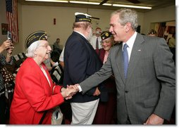 President George W. Bush greets members of the audience after attending a Fallen Soldiers National Memorial Ceremony at the American Legion Post 121 in Waco, Texas Sunday, Nov. 11, 2007. White House photo by Eric Draper
