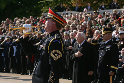 An U.S. Army Band bugler plays Taps during a wreath-laying ceremony at the Tomb of the Unknown Soldier, Sunday, Nov. 11, 2007, at Arlington National Cemetery in Arlington, Va. White House photo by David Bohrer