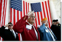 Veteran Warren G. King, Sr. of Nashville, center, salutes with fellow veterans Sunday, Nov. 11, 2007, during Veterans Day ceremonies at Arlington National Cemetery in Arlington, Va. White House photo by David Bohrer