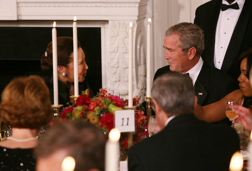 President George W. Bush shares a toast with Alma Powell, left, wife of former Secretary of State Colin Powell, Tuesday evening, Nov. 13, 2007 in the State Dining Room of White House, during a social dinner in honor of America's Promise-The Alliance for Youth. White House photo by Joyce N. Boghosian
