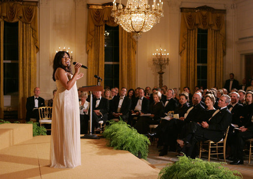 President George W. Bush, Mrs. Laura Bush and guests listen to singer Melinda Doolittle perform Tuesday evening, Nov. 13, 2007 in the East Room of the White House, during a social dinner in honor of America's Promise-The Alliance for Youth. White House photo by Joyce N. Boghosian