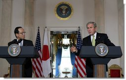 "As Prime Minister Yasuo Fukuda of Japan looks on, President George W. Bush makes remarks during a joint statement Friday, Nov. 16, 2007, in the Cross Hall of the White House. Said the President, ""The alliance between our two countries is rooted deeply in our strong commitments to freedom and democracy."" White House photo by Chris Greenberg"