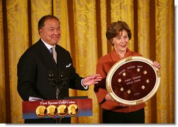 "Mrs. Laura Bush and U.S. Mint Director Ed Moy hold up the Dolly Madison Gold Coin Monday, Nov. 19, 2007, in the East Room. ""Today, we're paying tribute to an amazing First Lady, and an extraordinary woman, with the Dolly Madison Gold Coin,"" said Mrs. Bush. ""Over the last year, since the U.S. Mint launched the First Ladies series, these coins have been extremely popular: The likenesses of Martha Washington, Abigail Adams, and Jefferson's Lady Liberty sold out within hours of their release. Their appeal reflects the enthusiasm of America's coin collectors, the public's fascination with American history, and Americans' interest in our remarkable First Ladies."" White House photo by Joyce N. Boghosian"