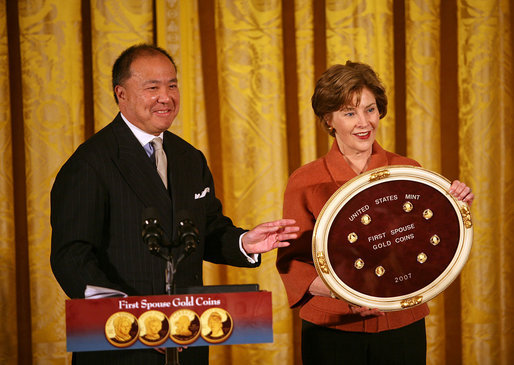 "Mrs. Laura Bush and U.S. Mint Director Ed Moy hold up the Dolley Madison Gold Coin Monday, Nov. 19, 2007, in the East Room. ""Today, we're paying tribute to an amazing First Lady, and an extraordinary woman, with the Dolley Madison Gold Coin,"" said Mrs. Bush. ""Over the last year, since the U.S. Mint launched the First Ladies series, these coins have been extremely popular: The likenesses of Martha Washington, Abigail Adams, and Jefferson's Lady Liberty sold out within hours of their release. Their appeal reflects the enthusiasm of America's coin collectors, the public's fascination with American history, and Americans' interest in our remarkable First Ladies."" White House photo by Joyce N. Boghosian"